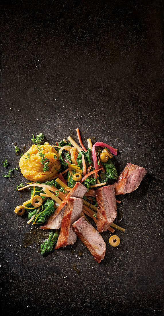Seared secreto with chickpea purée and chard salad