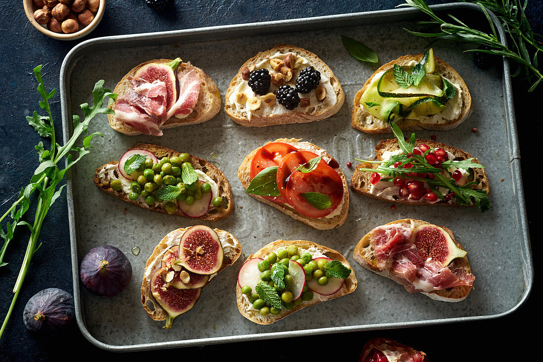 Various bruschettas with toppings