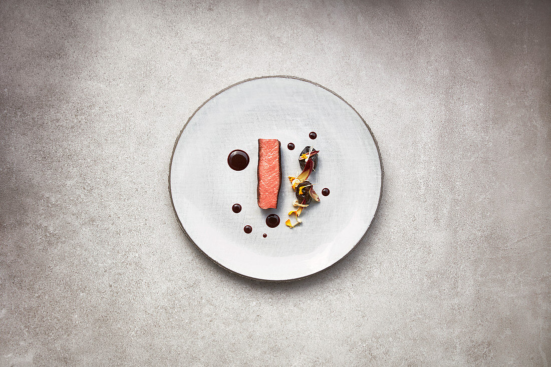 Saddle of venison with spicy damsons and cassis sauce