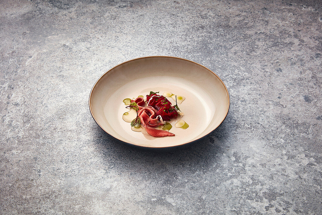 Beef heart with beetroot, leek oil and umami food
