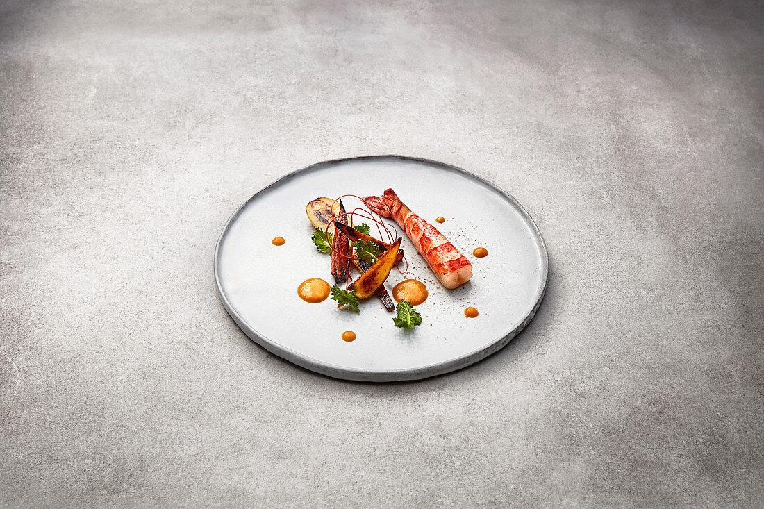 Sous vide prawns with roasted vegetables