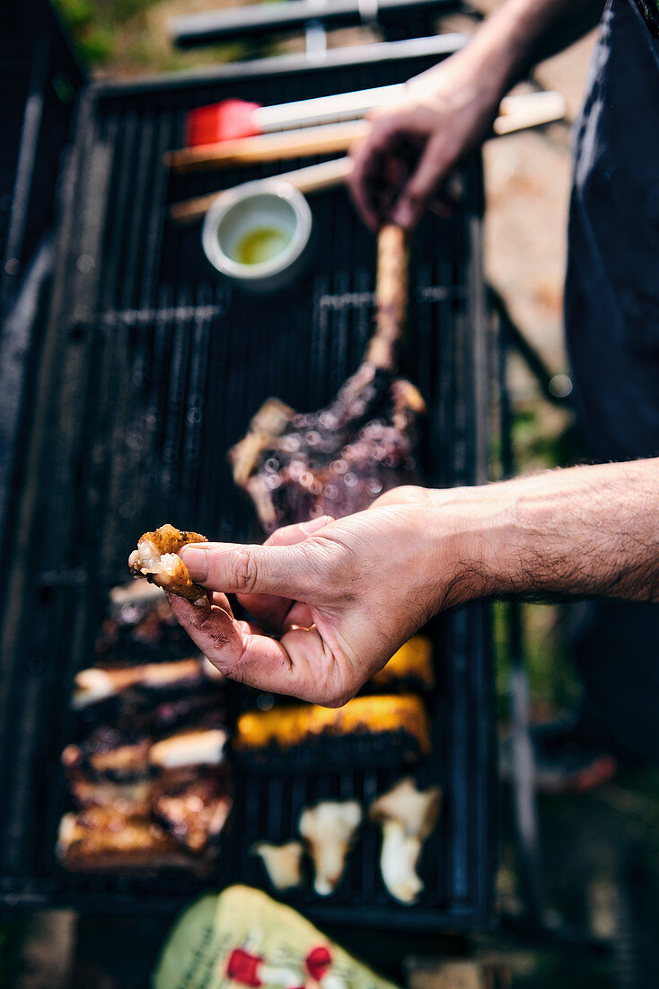 Hands above a grill