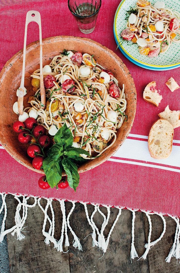 Spaghetti alla caprese with peppers, bacon and mozzarella