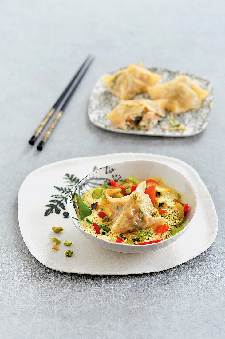 Asian fish dumplings with stir-fried vegetables and Thai curry sauce