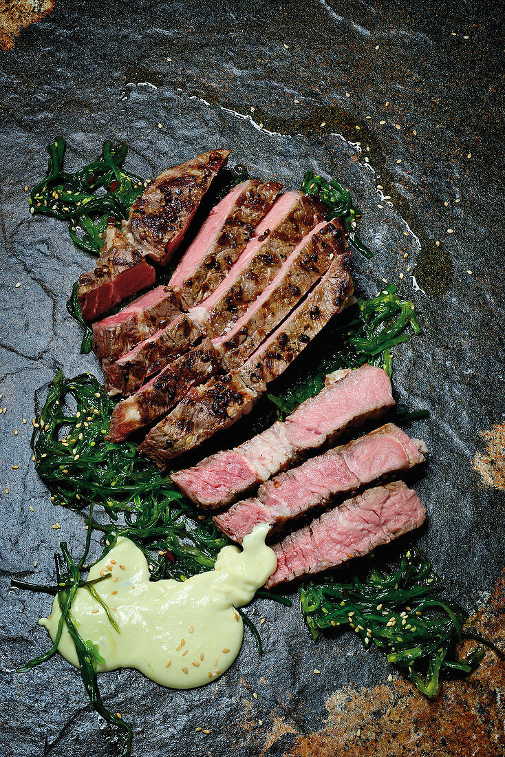 Grilled rib-eye steak with seaweed salad