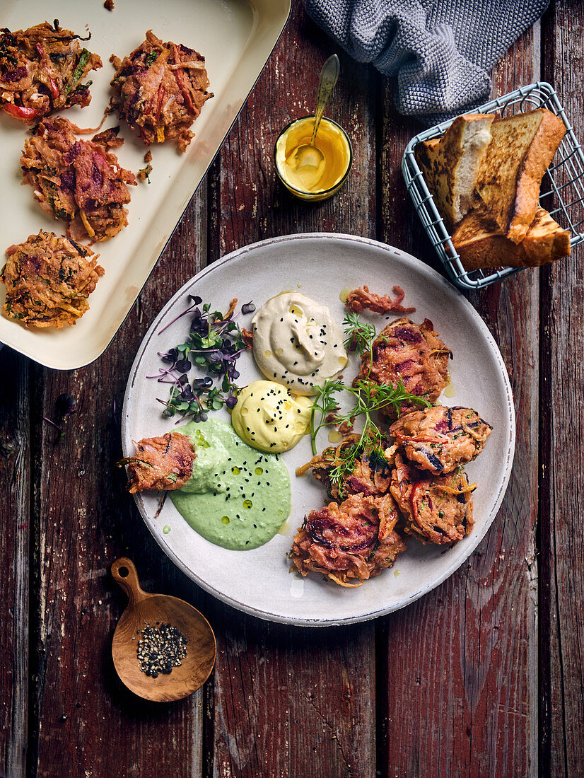 Pakoras made from peppers, onions, cabbage and chickpea flour with dips