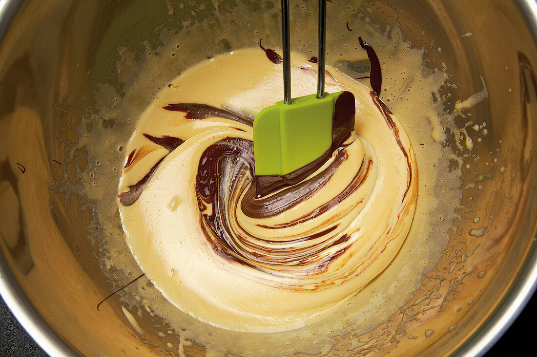 Egg yolk and melted chocolate being mixed