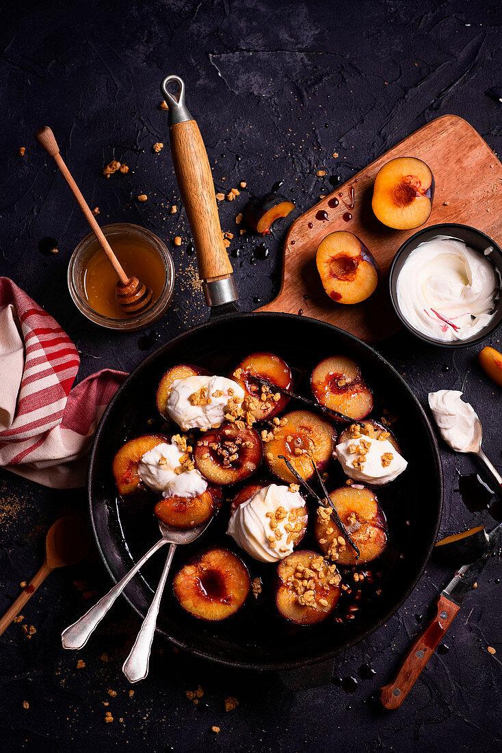 Autumn dessert of baked plums with yogurt and vanilla