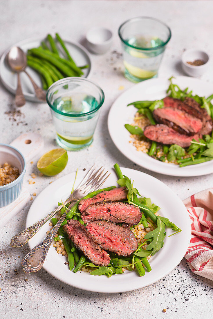 Beef slices with green beans and white sorghum