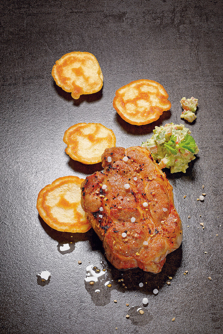 Grilled pork collar steak with guacamole and spelt pancakes