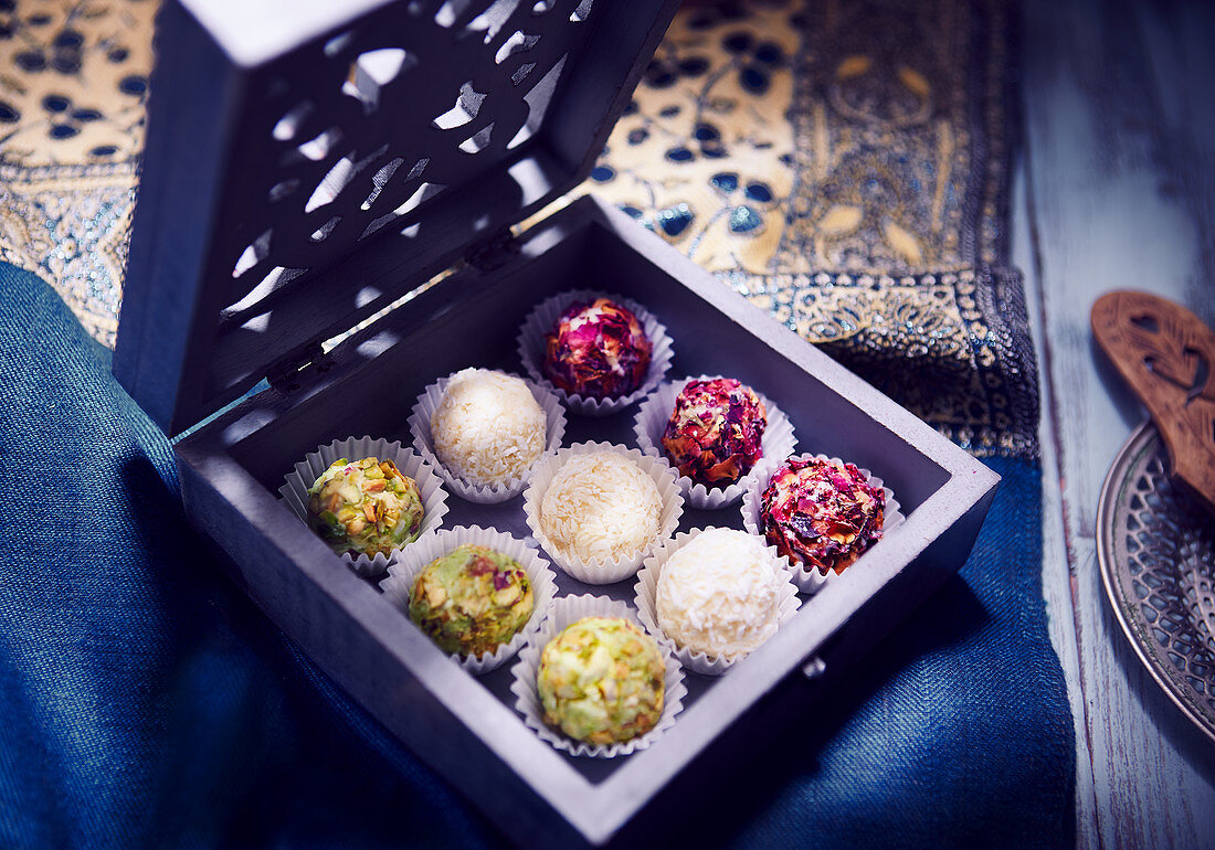 Laddu Box (Indian dessert) with roses, pistachios and coconut
