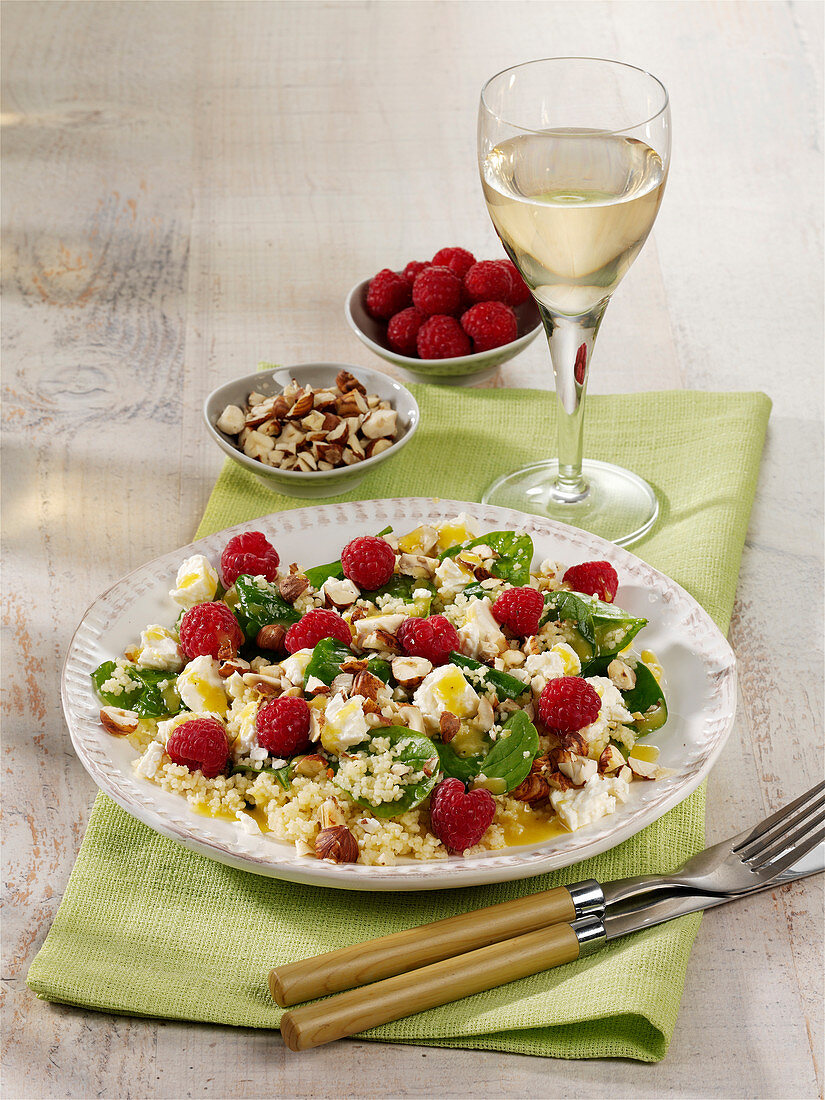Couscous salad with spinach, raspberry and feta cheese