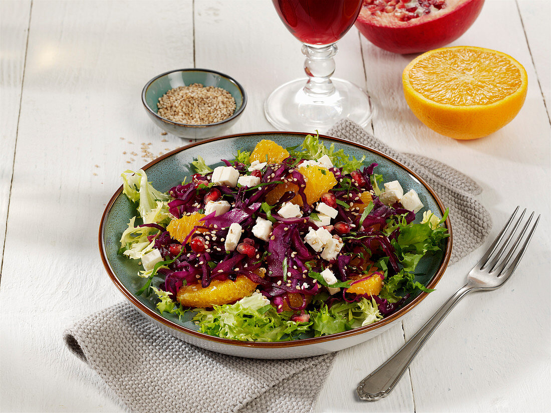 Warm red cabbage salad with feta cheese and oranges