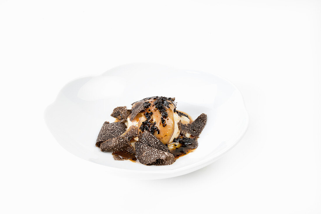 Poached egg with foie gras, Jerusalem artichoke puree and truffle jus