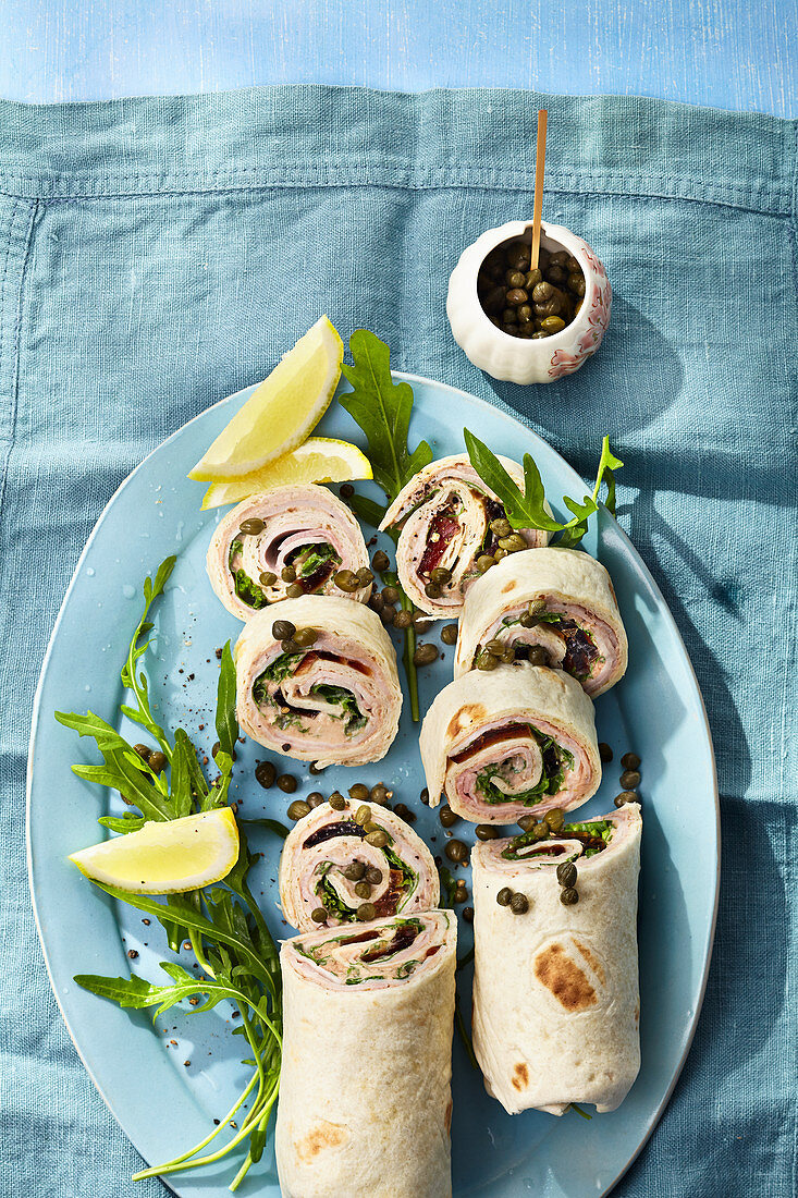 Burritos with squid, capers and cold roast meat