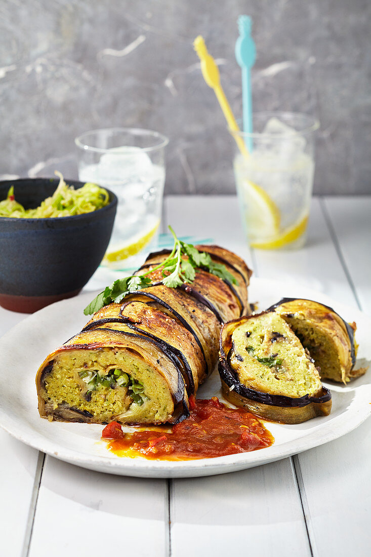 Falafel roulade wrapped in aubergine with a curry-tomato sauce