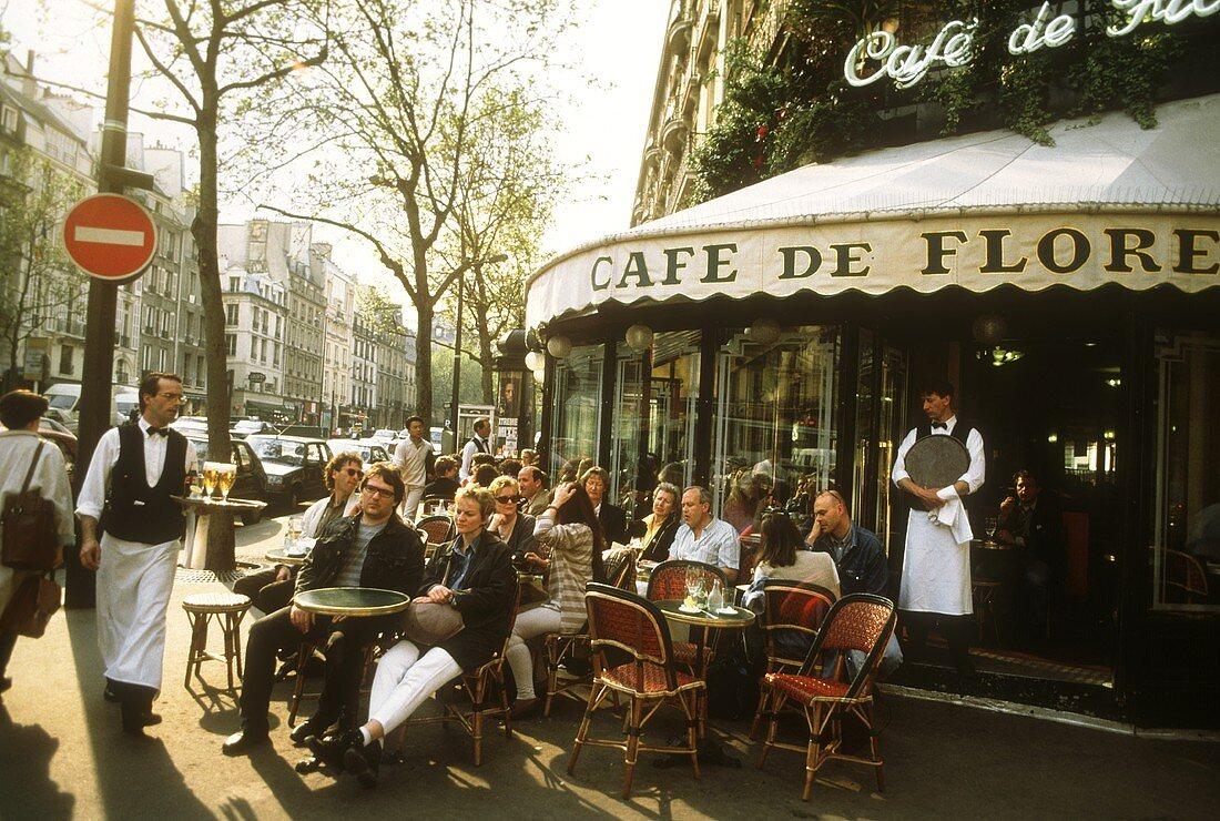 Guests at tables outside the Café de Flore, Paris