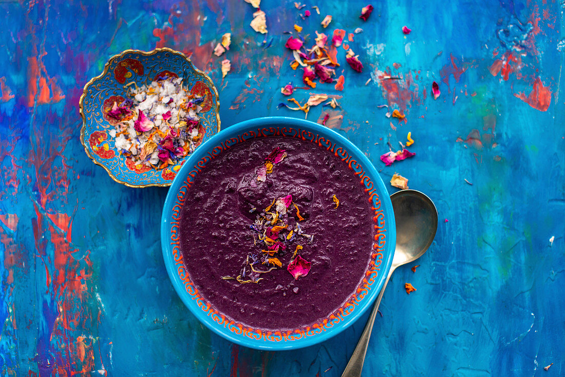 Roasted purple carrot and lentil soup topped with seasalt and edible petals