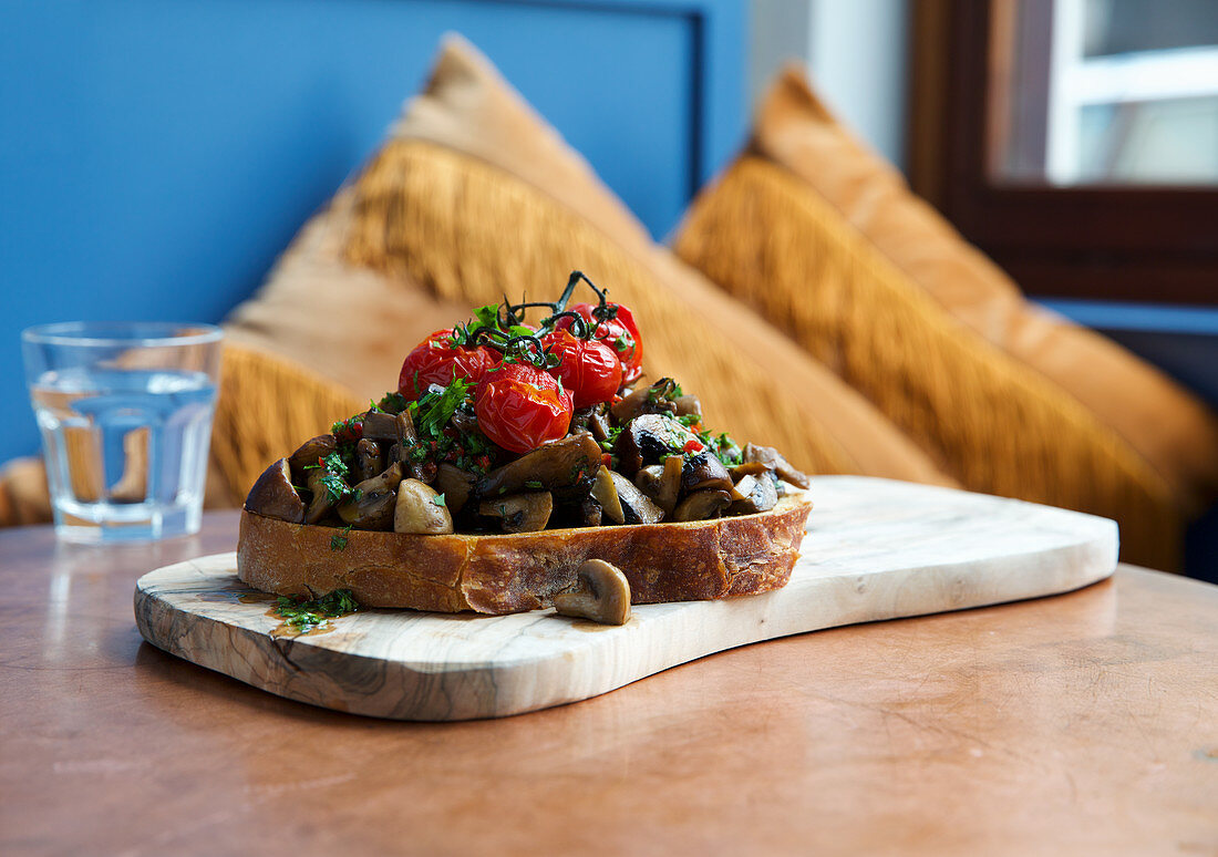 Mushrooms with oven tomatoes on toast