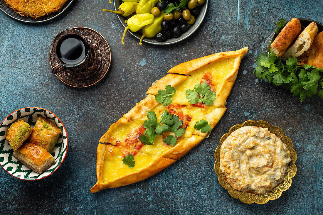 Pide - traditional Turkish pizza made of dough with minced meat, vegetables and melted cheese topping