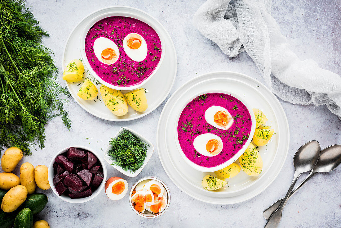 Saltibarsciai (cold Lithuanian beetroot soup) with boiled eggs and dill potatoes
