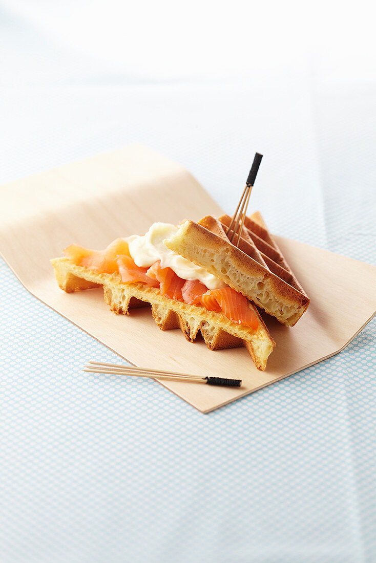 A waffle croque monsieur with smoked salmon