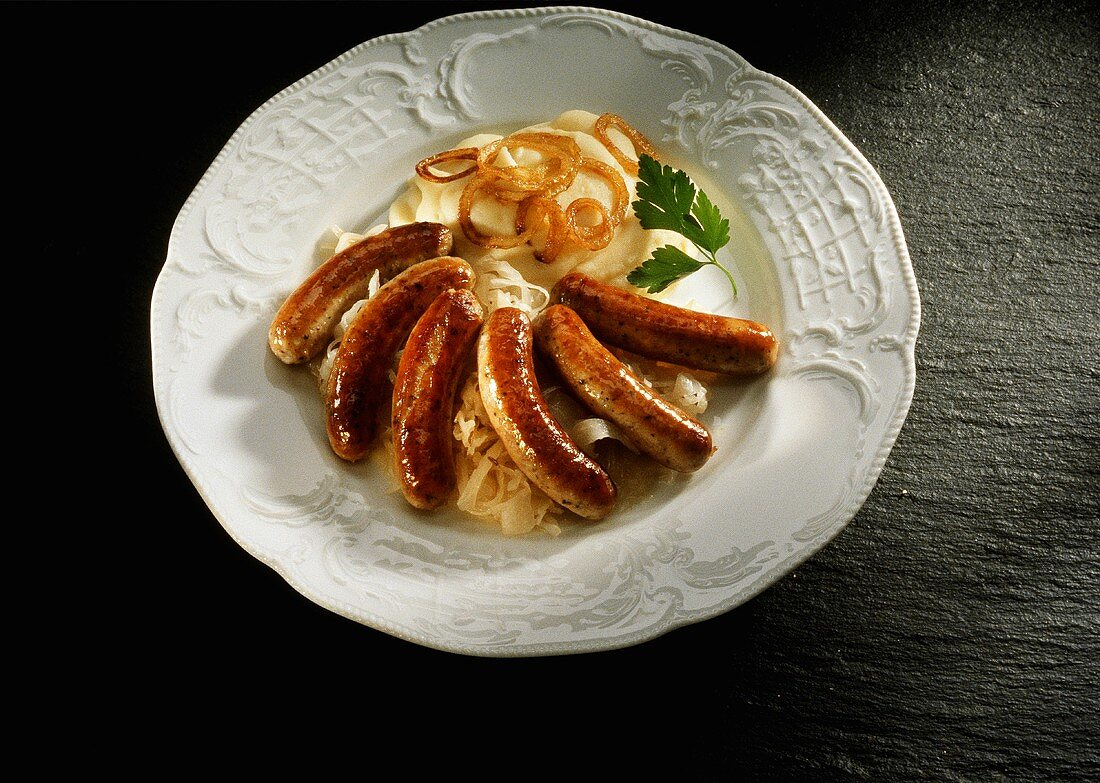 Nuremberg sausage with sauerkraut and mashed potato