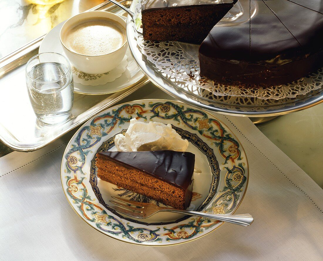 A piece of Sacher torte with fresh whipped cream