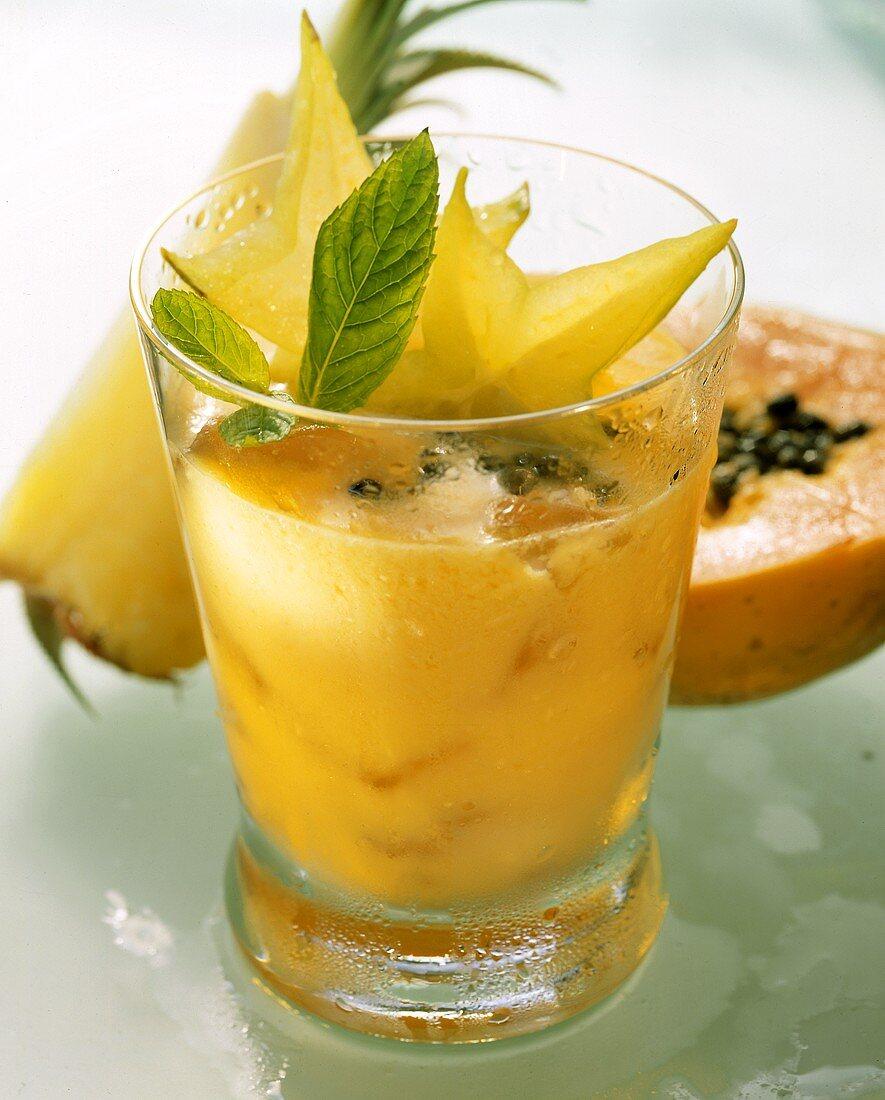 Papaya and pineapple drink with carambola stars & mint