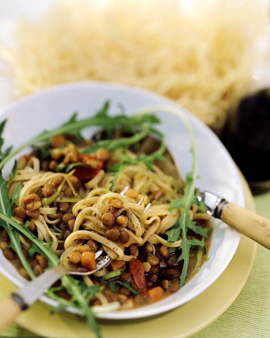 Narrow ribbon noodles with balsamic lentils & rocket