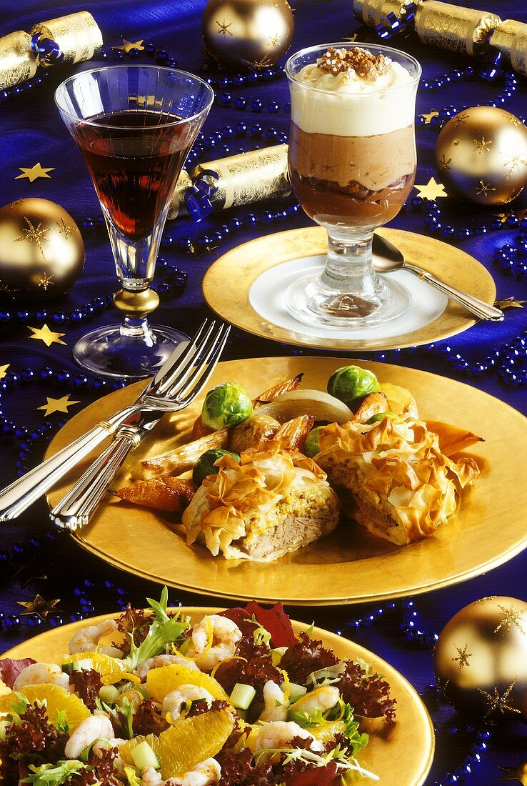 Christmas menu with salad, beef with pasta crust & mousse