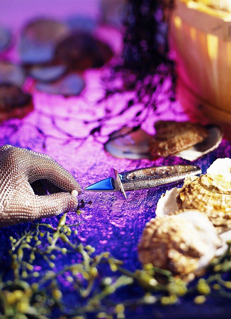 Oyster, oyster-knife, -glove & pearl on violet background