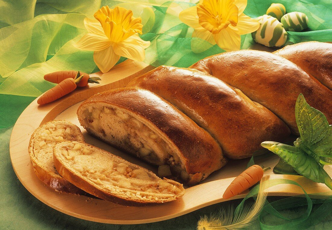 Apple plait on wooden tray with spring decoration