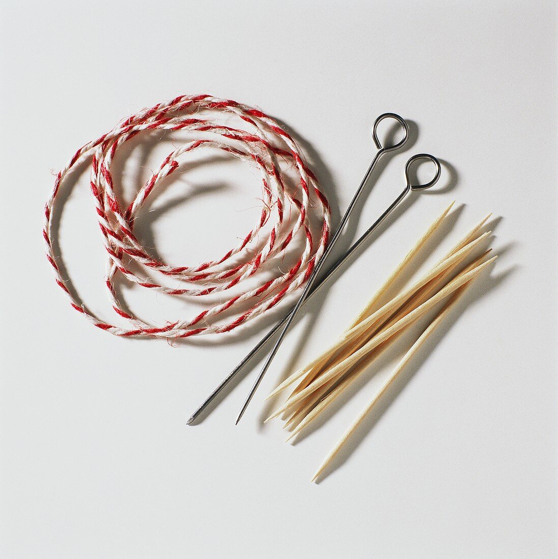 Wooden skewers, roulade needles and string