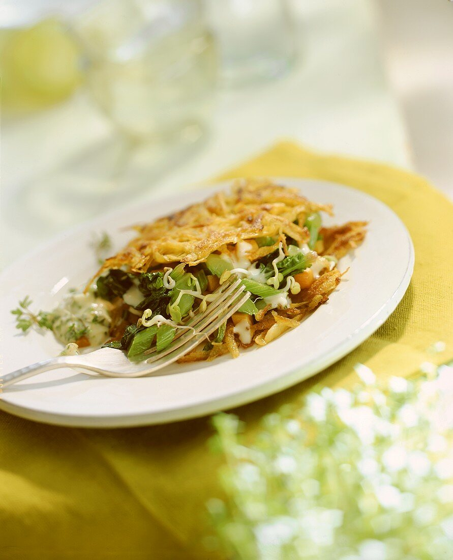 Potato rosti with vegetable filling & tartar sauce on plate