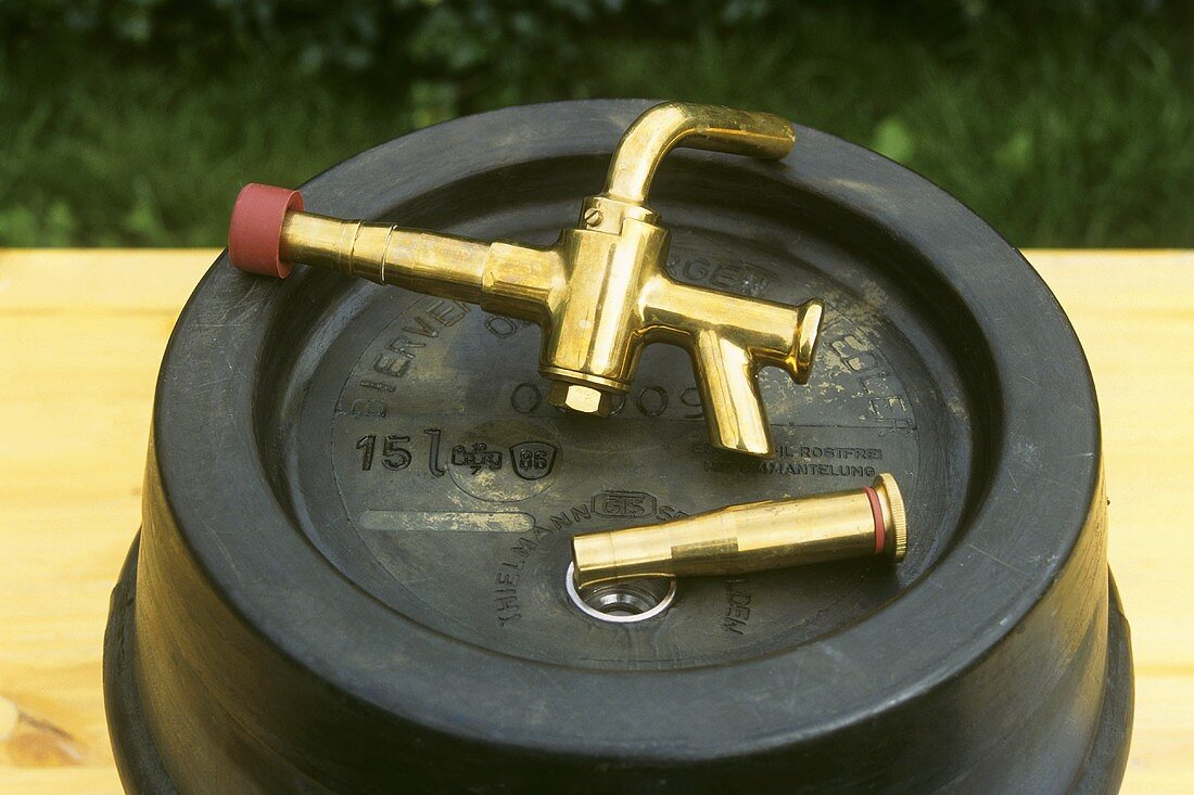 Tapping equipment lying on beer barrel