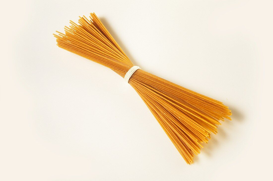 A bundle of wholemeal spaghetti (tied together with string)