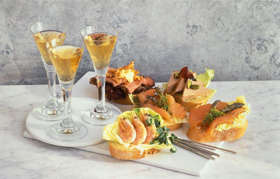 Smorgasbord, with various toppings & three glasses of Akvavit