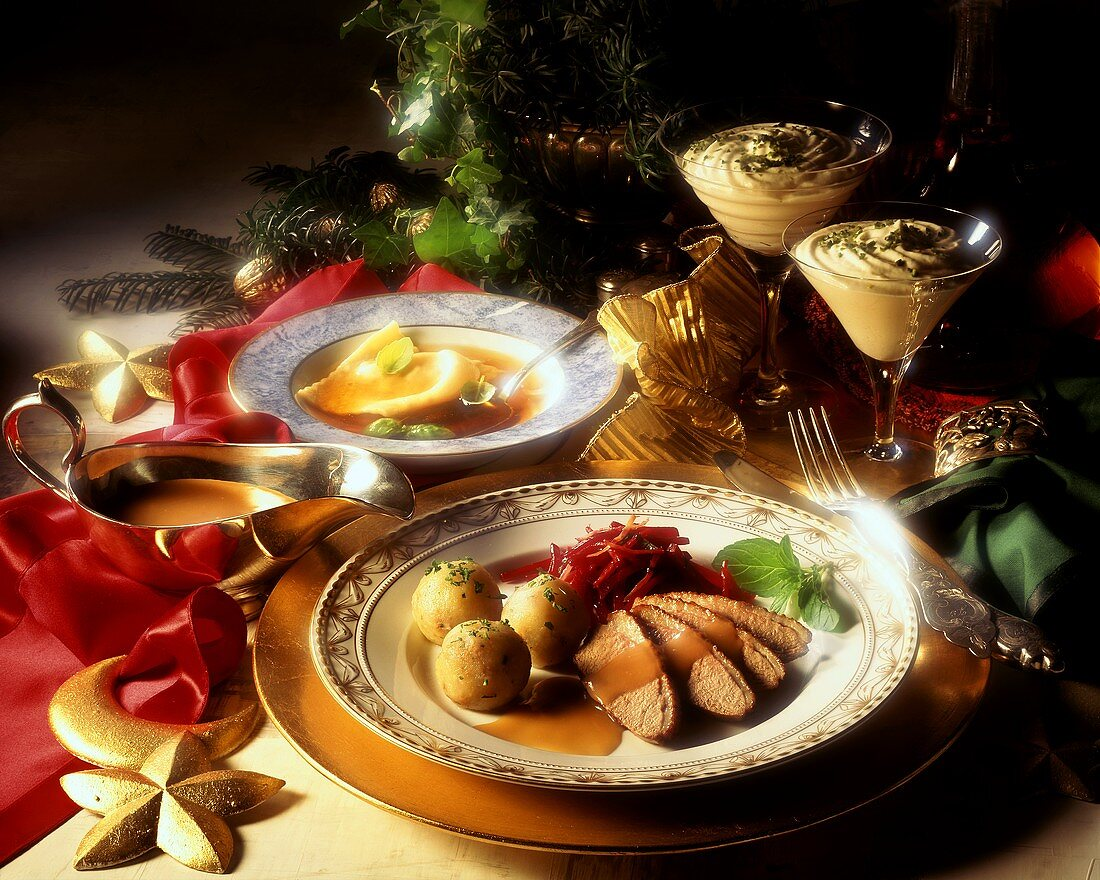 Christmas menu with duck breast, ravioli soup & mousse