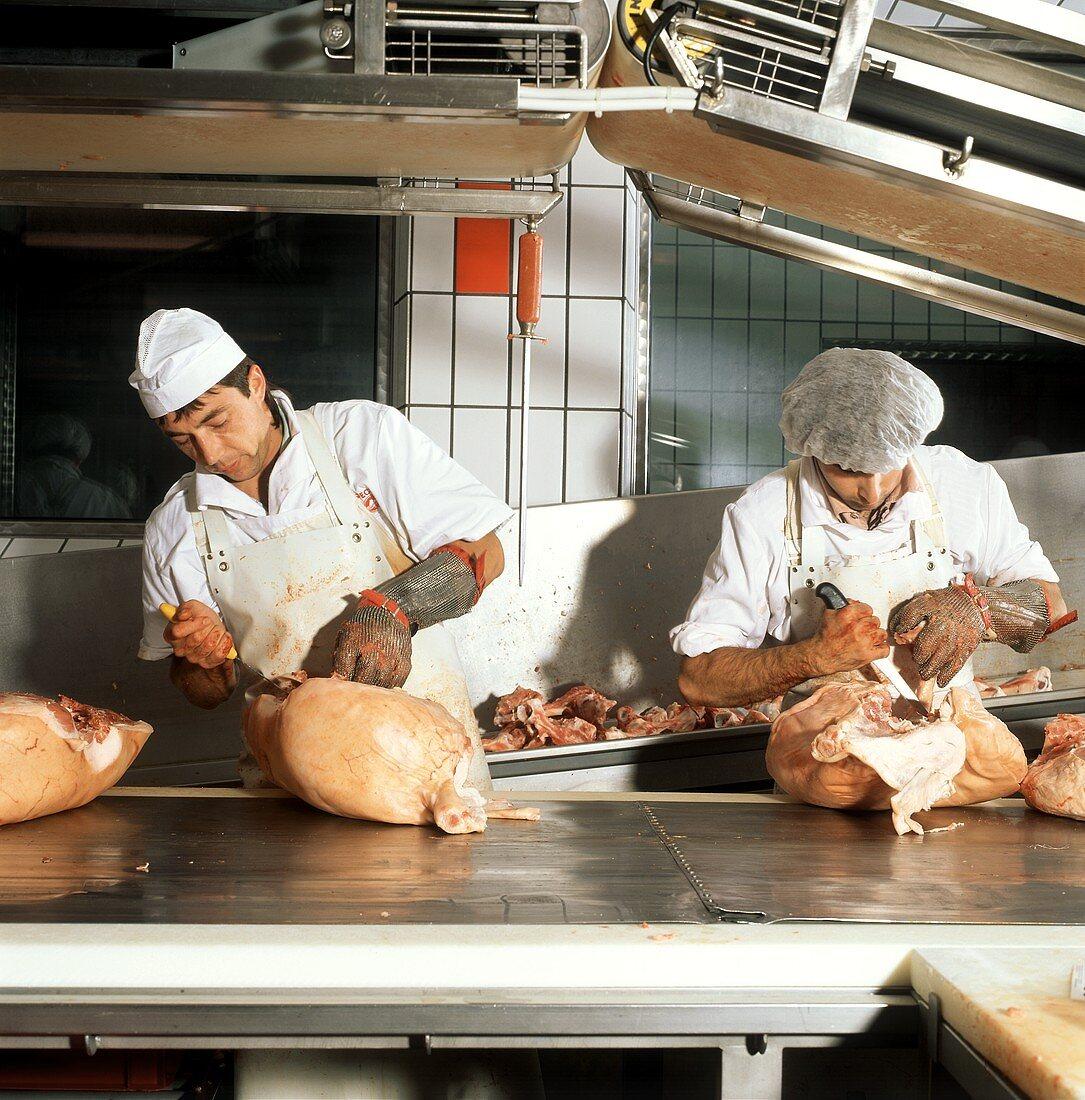 Two Butchers Cutting Pork