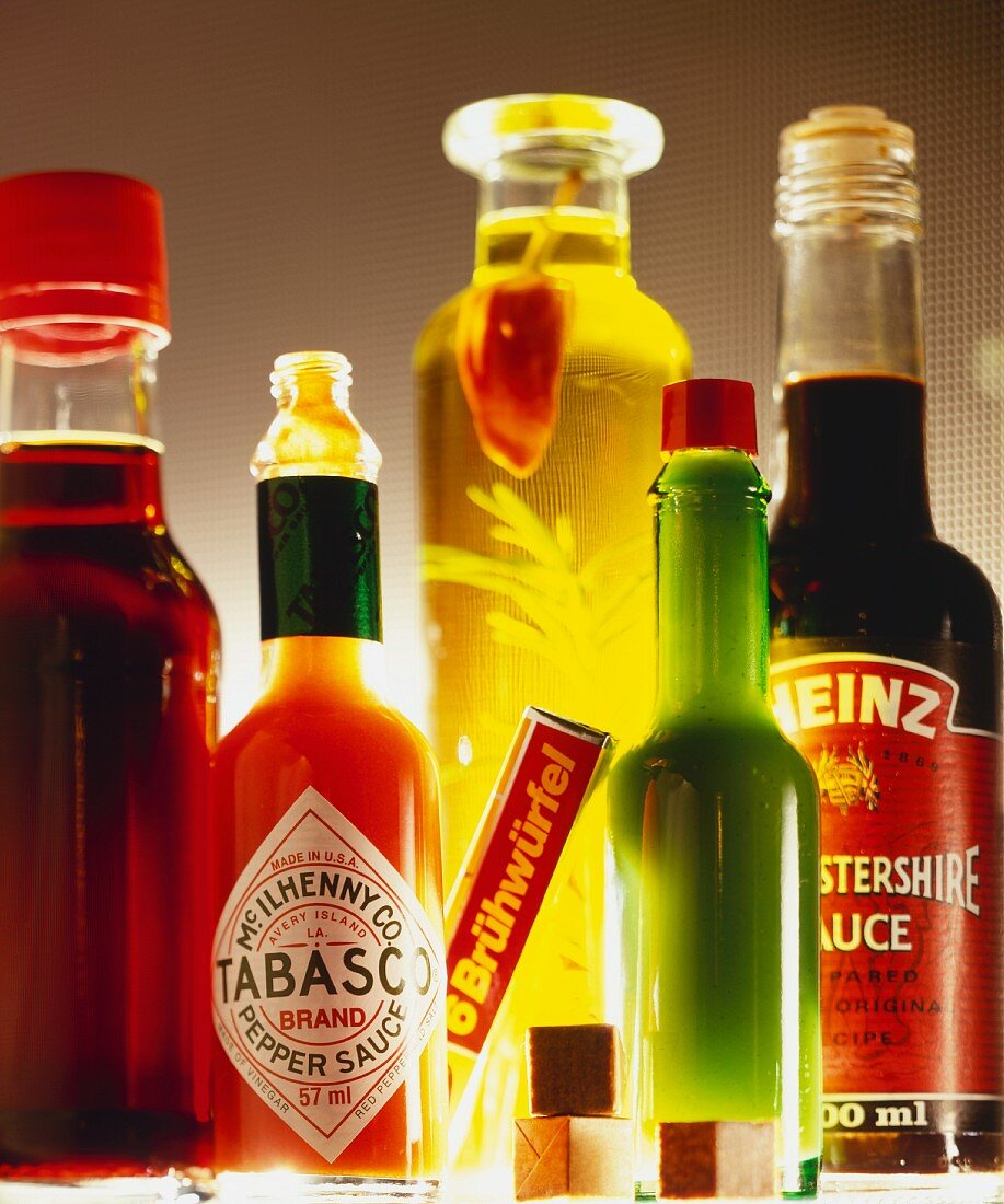 Various spicy sauces, oil and stock cubes