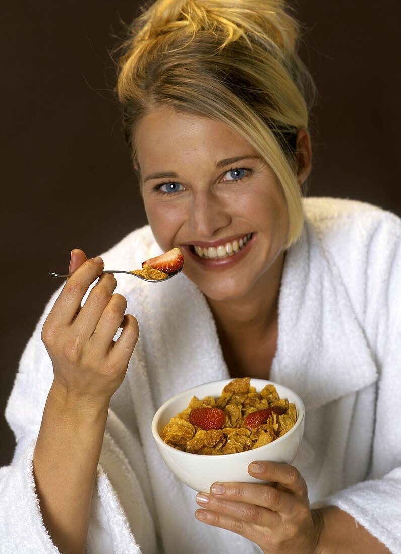 Woman Eating Cereal with Strawberries