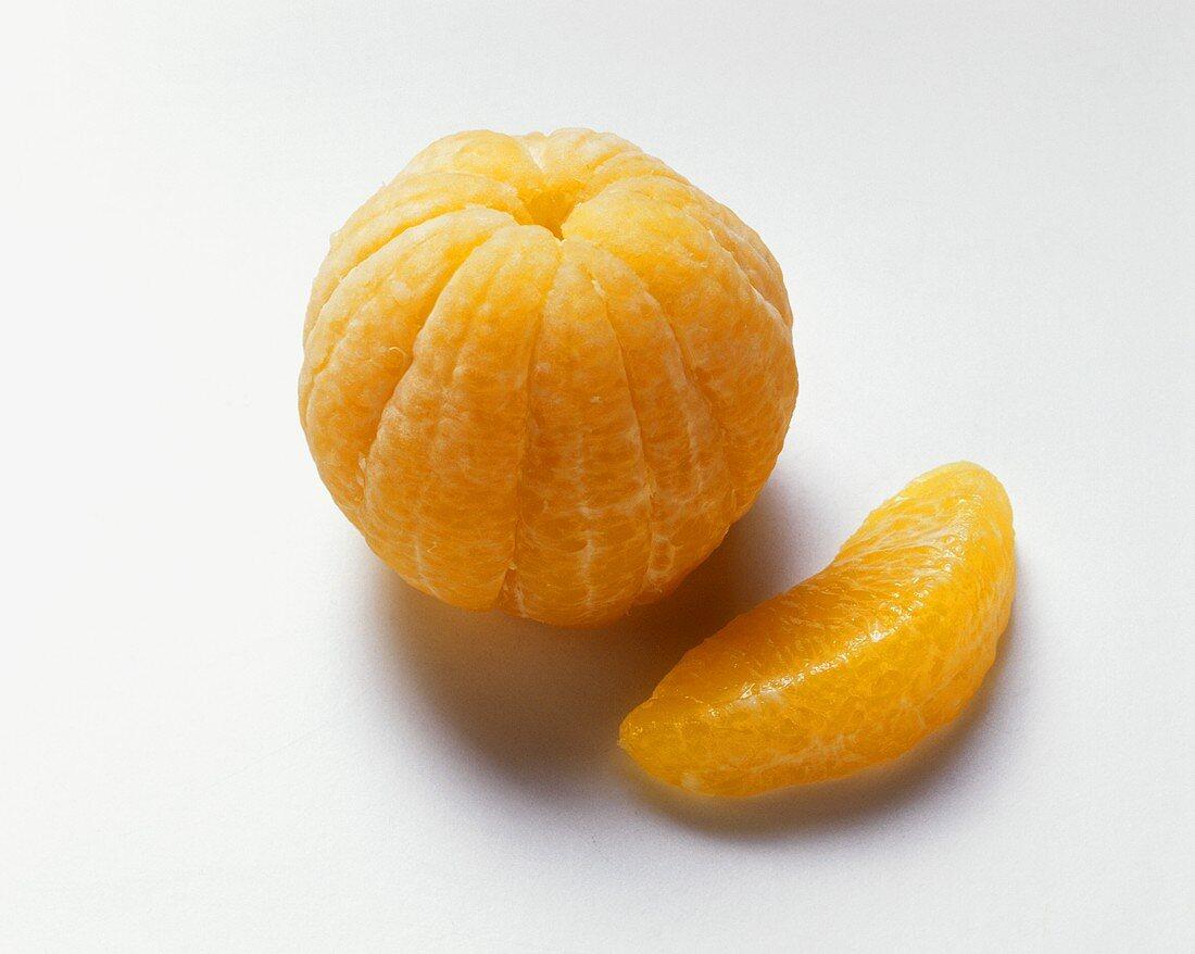 Peeled mandarin and a segment