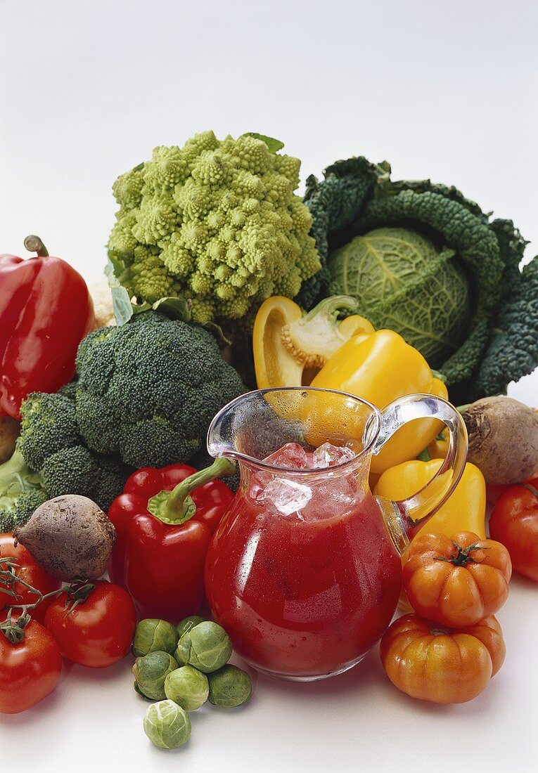 Still life with fresh vegetables & cold tomato juice