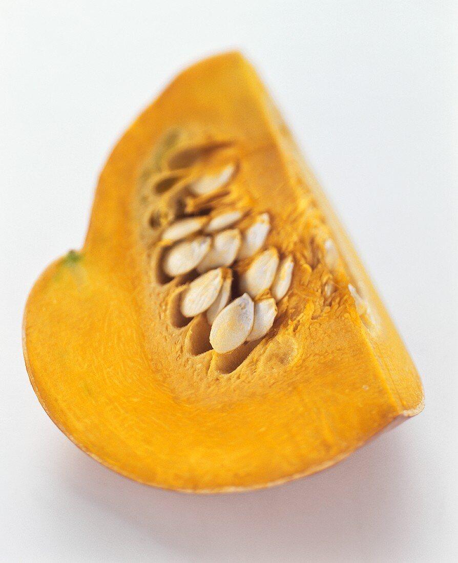 Segment of orange pumpkin with seeds