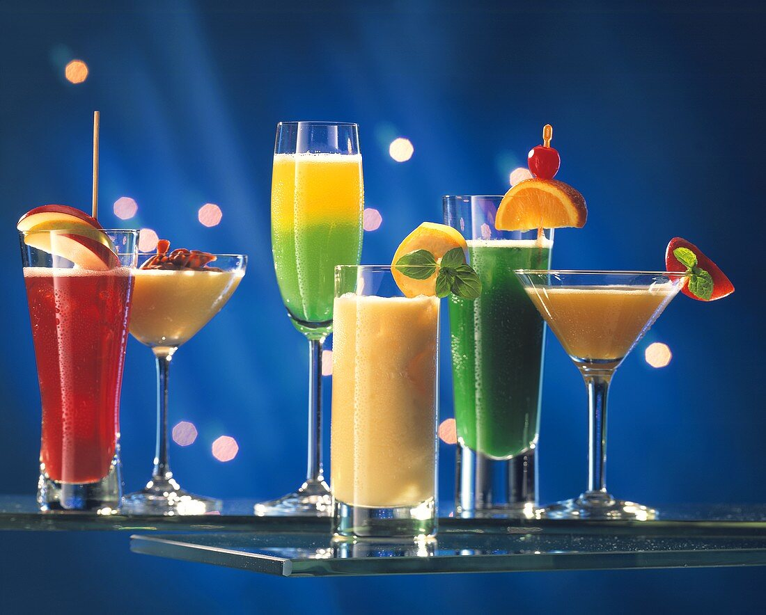 Various non-alcoholic drinks against a blue backdrop