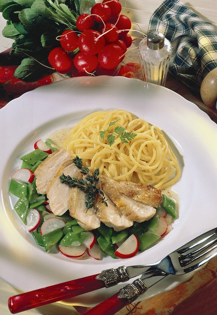 Chicken breast fillet with mangetouts, radishes & spaghetti