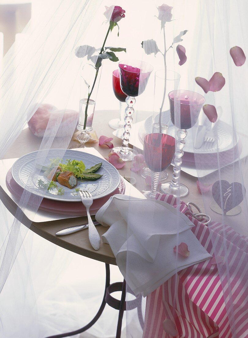 Romantic table with stuffed smoked salmon as appetiser