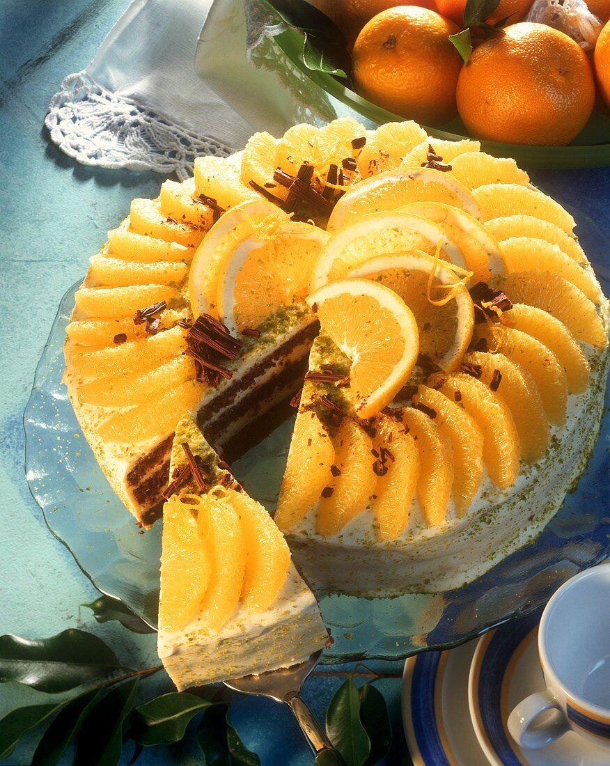 Orange and chocolate gateau, one piece cut