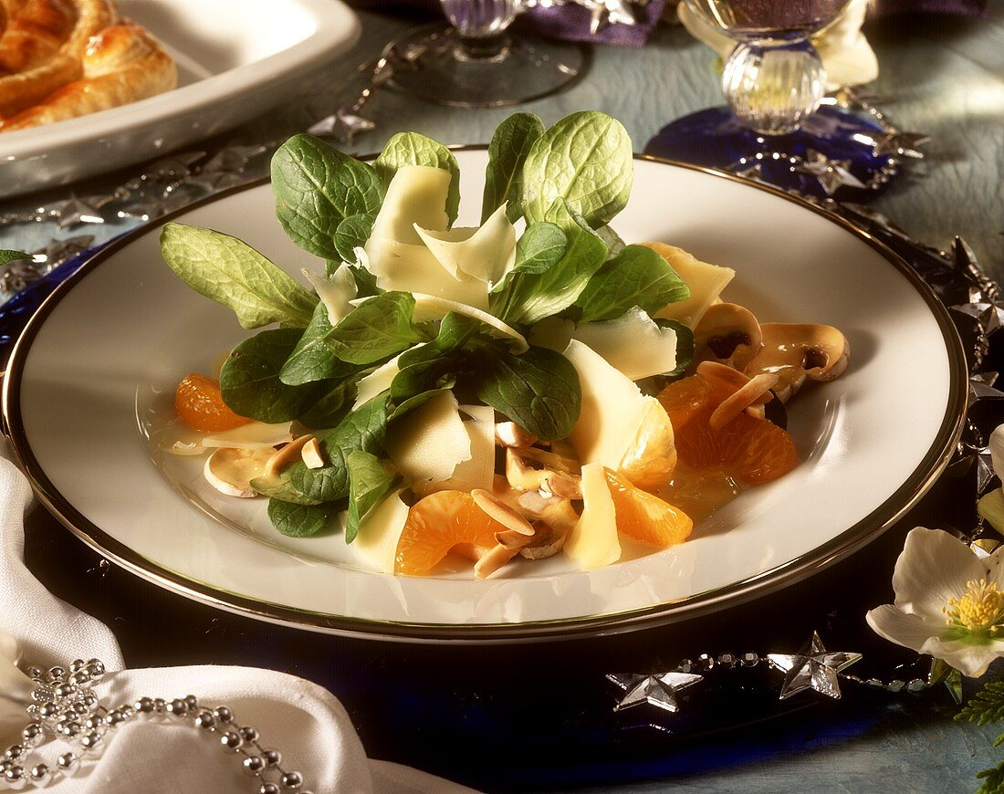 Corn salad with cheese planes and mandarins